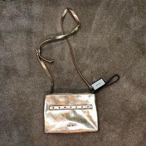 NWT- Nine West crossbody clutch/purse rose gold
